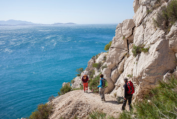 hikers on the edge of mediterranean sea Wall mural