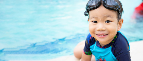 Banner Web Design of Child enjoying in swimming pool