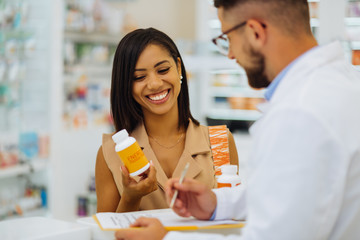 Photo sur Plexiglas Pharmacie Happy female person looking at pills for skincare