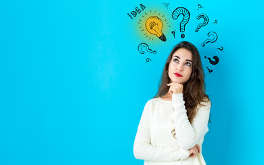 Idea light bulbs with question marks with young woman in a thoughtful face