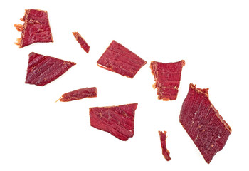 Beef jerky on a white white background, top view.