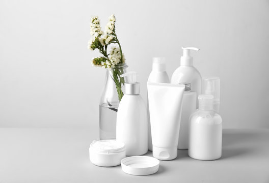 Set of cosmetic products on light background