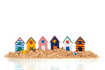 Colorful handmade beach cabins on island Wall mural