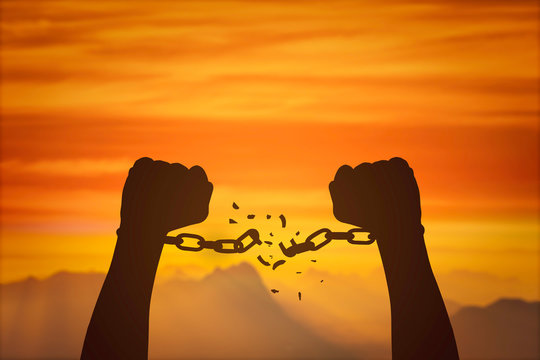 silhouette hands and broken chains .Freedom concept