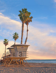 Life guard tower – Life guard tower with palm trees at sunset in California