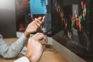 Business Team Investment Entrepreneur Trading discussing and analysis graph stock market trading,stock chart concept stock photo