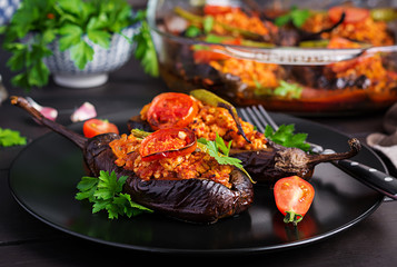 Karniyarik - turkish traditional aubergine eggplant meal. Stuffed eggplants with ground beef and vegetables baked with tomato sauce. Turkish cuisine.