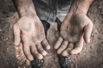 Dirty hands of a worker man