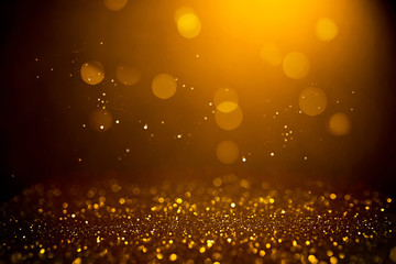 Golden abstract bokeh on black background. Holiday concept Wall mural