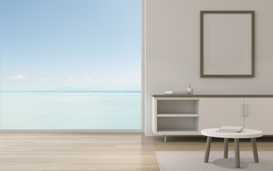 Mock-up of room with picture frame and  small cabinet on sea view background. Perspective of minimal interior design. 3d rendering.