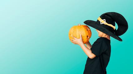 Happy child with Halloween jack o lantern pumpkin