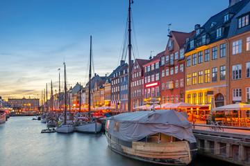Nyhavn landmark buildings at night in Copenhagen city, Denmark
