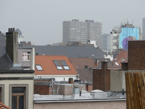 Old rooftops. Old windows. Roof terrace. Satellite dishes on the building.