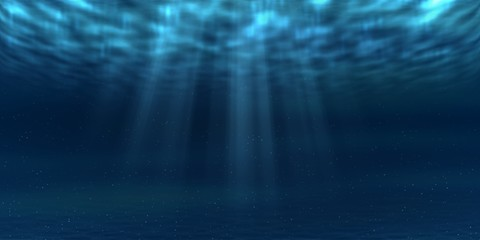 Sun and sunbeams underwater shining through ocean surface. Sea deep underwater