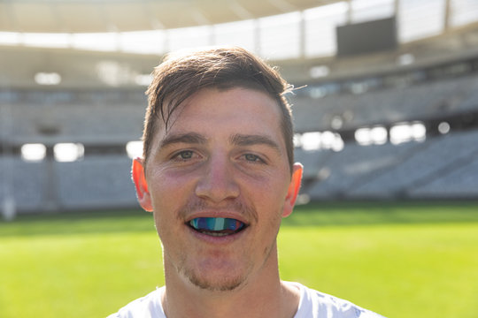 Male rugby player with mouth guard in stadium