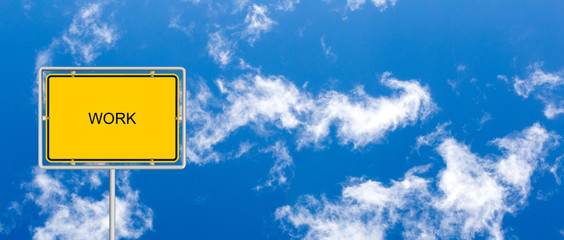 yellow road sign with WORK on blue sky