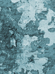 Grunge wall background. Blue colored grunge background with torn posters.