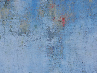Blue Wall with cracked surface. Grunge background.
