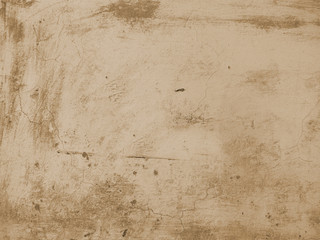 Scratched wall grunge background. Brown colored grunge background with old wall.