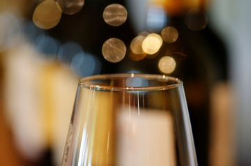 A glass is displayed in front of bottles of French red wine at the Chateau du Pavillon in Saint-Croix-Du-Mont