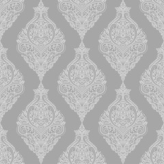 Grey and white floral seamless pattern with ornamental stripes. Traditional oriental motifs. Vintage ornament template. Decorative paisley elements. Great for fabric and textile.