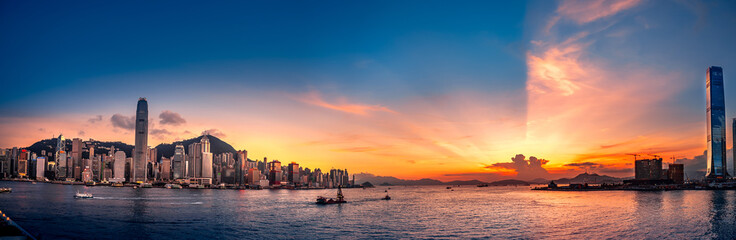 People enjoy the beautiful sunset in front of Victoria Harbor, Hong Kong