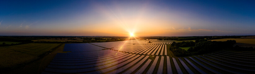 Solar farm panoramic at sunrise Wall mural