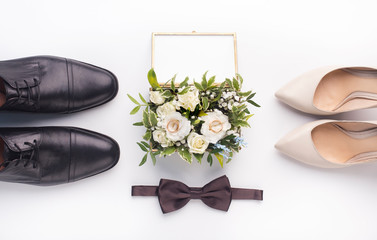 Wedding shoes and bouquet on white background