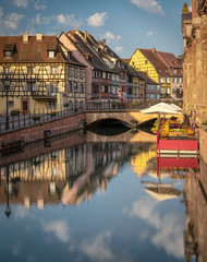 Flanked by colourful half-timbered fishermen's houses, the Quai de la Poissonnerie runs alongside the Lauch River. Colmar, Alsace, France in the Petite Venise area.