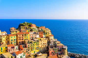 Wall Mural - Colorful houses in Manarola Village in Cinque Terre National Park. Beautiful scenery at coast of Italy. Fisherman village in the province of La Spezia, Liguria, Italy