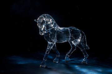 Fototapeta Crystal horse on a dark blue background among the star dust