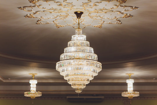 Close-up of a beautiful crystal chandelier Beautiful chandelier. luxury expensive chandelier hanging under ceiling.