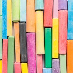 colored chalks like background, concept of education or business