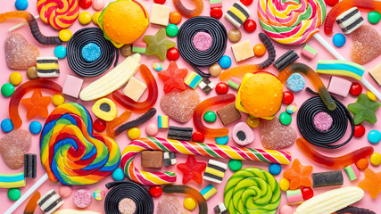 beautiful colourful festive sweets and candies like background, top view, panorama