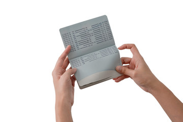 two hands open passbook for checking balance of staement with white background and clipping path
