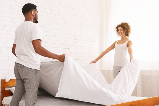 Charming couple in love making bed together