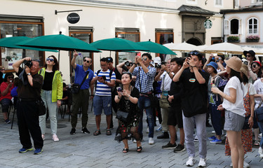 Tourists take a picture of Wolfgang Amadeus Mozart's birth house in Salzburg