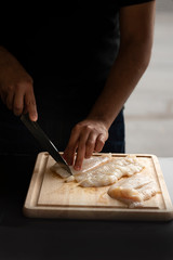 Chef cutting fish - fillet