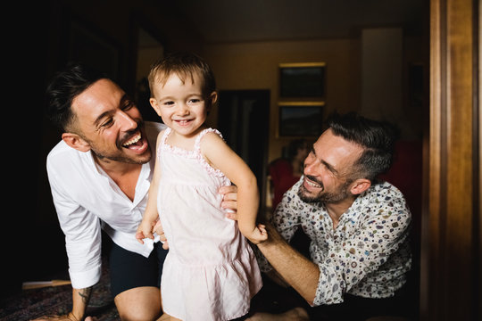 Couple playing with their daughter at home