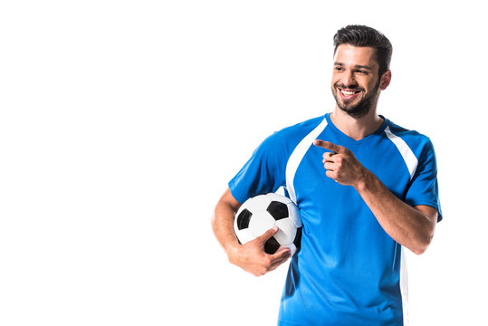 happy soccer player with ball pointing with finger Isolated On White