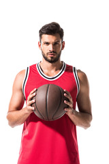sportive basketball player holding ball and looking at camera Isolated On White
