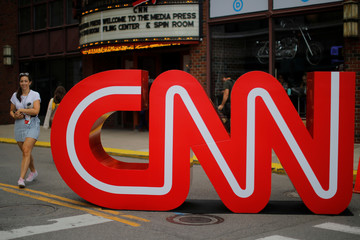 The CNN logo stands outside the venue of the second Democratic 2020 U.S. presidential candidates debate, in the Fox Theater in Detroit