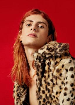 Portrait of redhead woman in fur coat