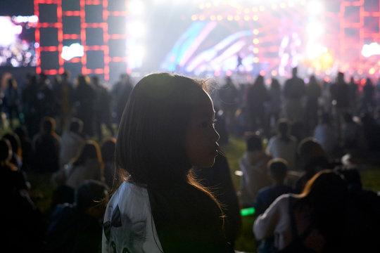 Asian little girl at the music festival