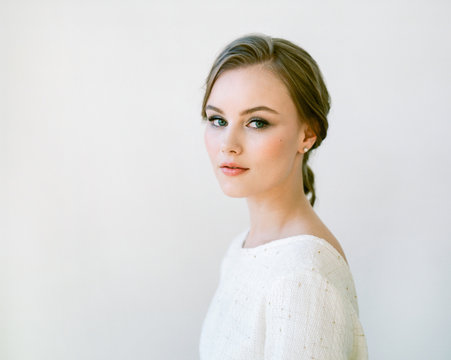 Beautiful woman with nude makeup.