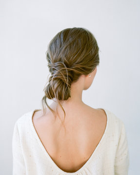 Back view of woman hairdo. Wedding hairstyle.