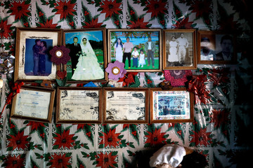 Framed pictures and diplomas are seen at the house of Dolores Morales Lopez, grandmother of Guatemalan migrant Ledy Perez, in the community of Santa Amelia