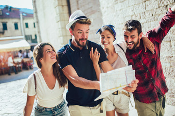 Happy group of tourists traveling and sightseeing together Wall mural