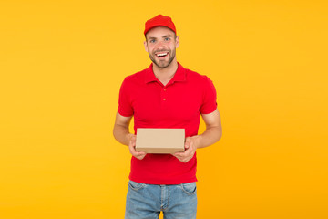 Courier service delivery. Salesman and courier career. Courier and delivery service. Postman delivery worker. Happy man post package yellow background. Delivering your purchase. Gifts for holidays