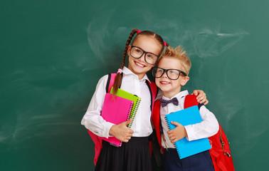 funny group children   schoolboy  and schoolgirl, student boy  and girl about school blackboard - fototapety na wymiar